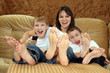 Caucasian mother with her sons sitting