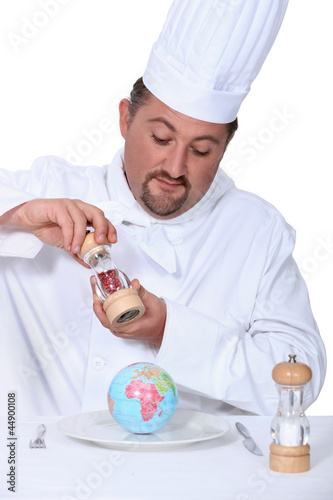 a cook seasoning a globe