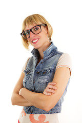 Portrait of young woman with nerdy glasses and jeans jacket