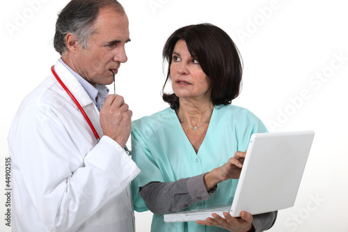Two hospital workers with laptop