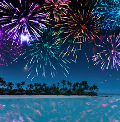 Festive New Year's fireworks over the tropical island..