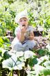 baby girl eats cucumbers