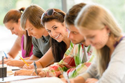 Leinwanddruck Bild Students writing at high-school exam teens study