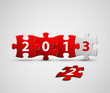 New Year 2013 card made from red and white puzzle pieces
