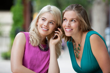 Women Using A Mobile Phone