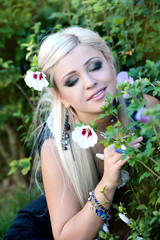 beautiful woman in garden with flowers