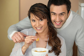 Couple eating from bowl