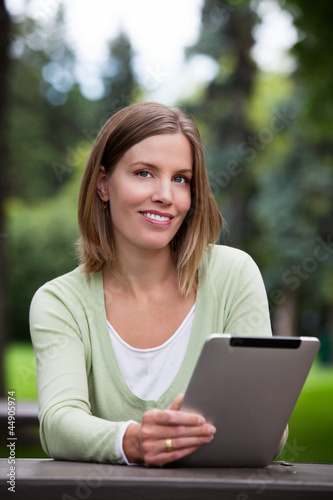 Woman holding Digital Tablet