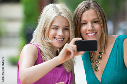 Female Friends Photographing Themselves