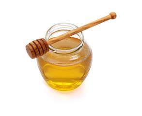 Honey with wood stick , isolated on white background