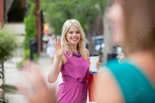 Women Waving Each Other