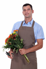a florist with a flowers bouquet