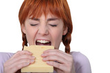 Girl biting piece of cheese