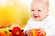 Baby holding apples