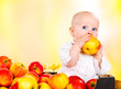 Toddler eating autumnal apples