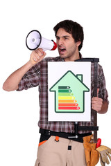 Man with speaker and energy rating sign