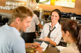 Fototapety Couple paying bill at cafe cash desk
