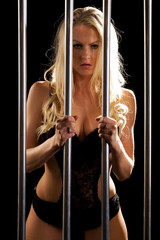 beautiful sexy woman in lingerie locked in prison cell