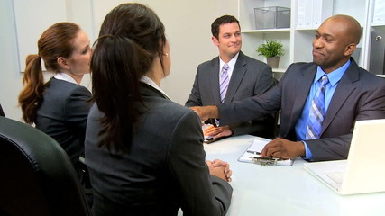 Multi Ethnic Attorneys with Clients