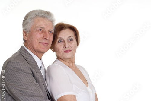 An elderly man with a woman standing
