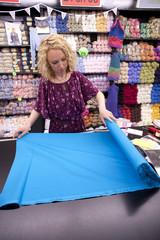 female cutting fabric