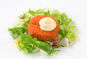 Fried cheese with green salad and mayonnaise
