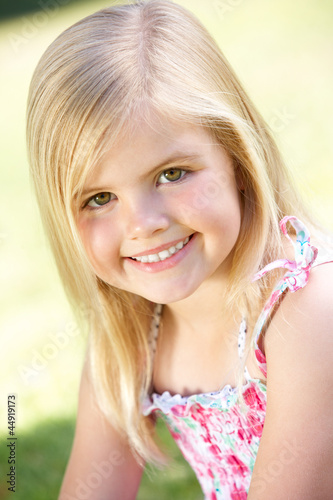Outdoor Portrait Of Smiling Young Girl