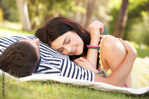 Couple Relaxing Together In Garden