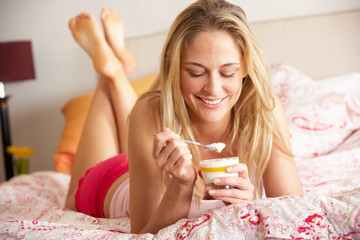 Pretty Woman Eating Dessert In Bed