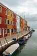 Multicoloured building at a canal in Burano, Italy.
