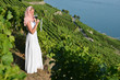 Woman tasting red wine among vineyards in Lavaux, Switzerland