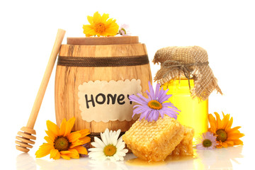 Sweet honey in jar and barrel with honeycomb, wooden drizzler