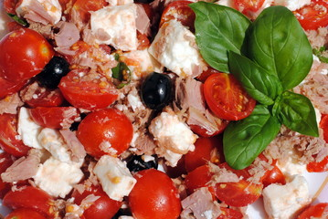 close up of salad with tomatoes and basil