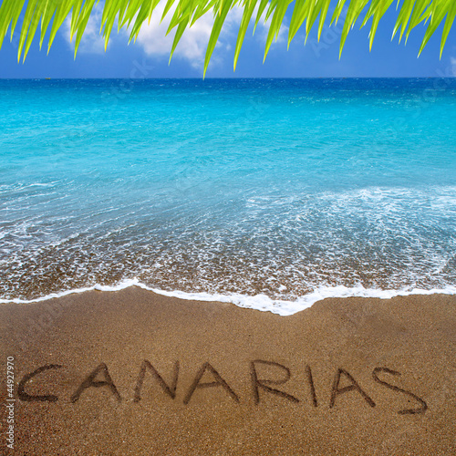 Brown beach sand with written word Canarias
