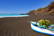 Beach el Bollullo black brown sand and aqua water
