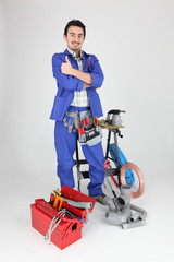 Plumber standing with various tools and material