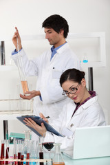 male and female laboratory technicians