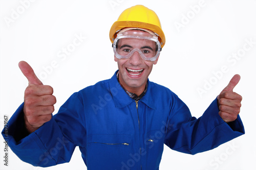 Elated tradesman giving two thumb's up