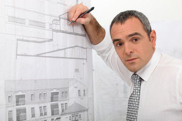 An architect drawing a plan