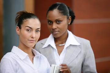 Two businesswomen stood outside office