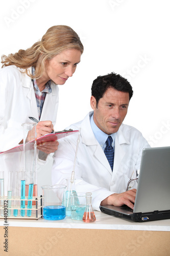 lab assistants on computer