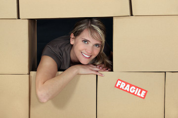 Female logistics manager surrounded by boxes