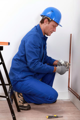 Construction worker installing a pipe