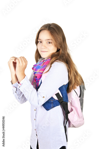 girl with backpack showing heart by hands over white
