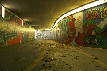 dirty pedestrian underpass with graffitis