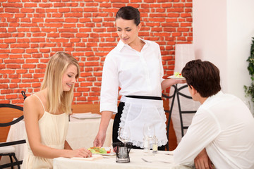 couple and waitress at restaurant