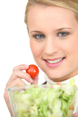 Blond eating fresh salad
