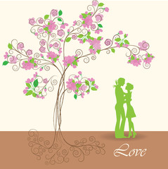 Silhouettes of  young man and girl under a spring tree