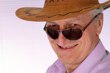 Elderly man in a cowboy hat feels fine