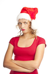 Unhappy young woman on white background. Christmas